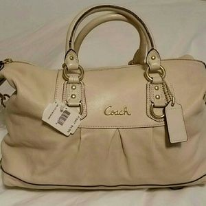 New Coach Duffel MSRP $498. Bone Color. Great for